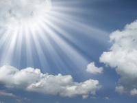 sun-rays-coming-out-of-the-clouds-in-a-blue-sky-wallpaper