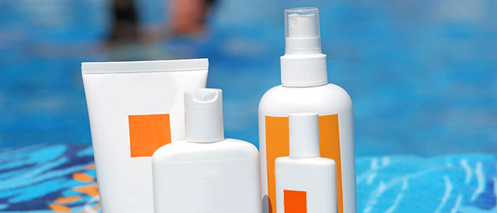 Sunscreen_bottles_on_towel_iStock_000006513786Large