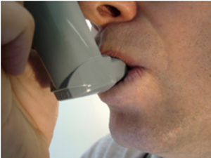 Man with an asthma inhaler
