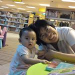 mei and eczema baby in library