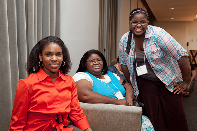 Three smiling women of color at National Eczema Association's Patient Conference