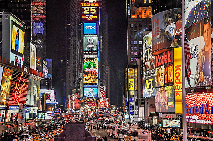 Times Square billboards at night.