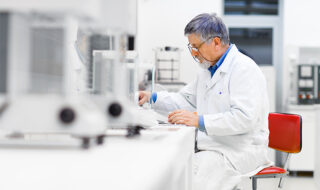 scientist performs research in laboratory